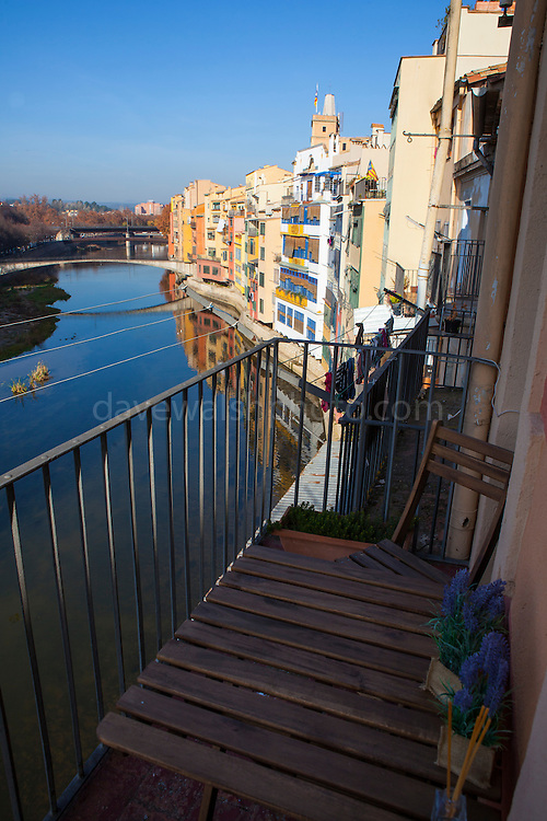 Table on balcony over the River Onyar, Girona, Catalonia, Spain