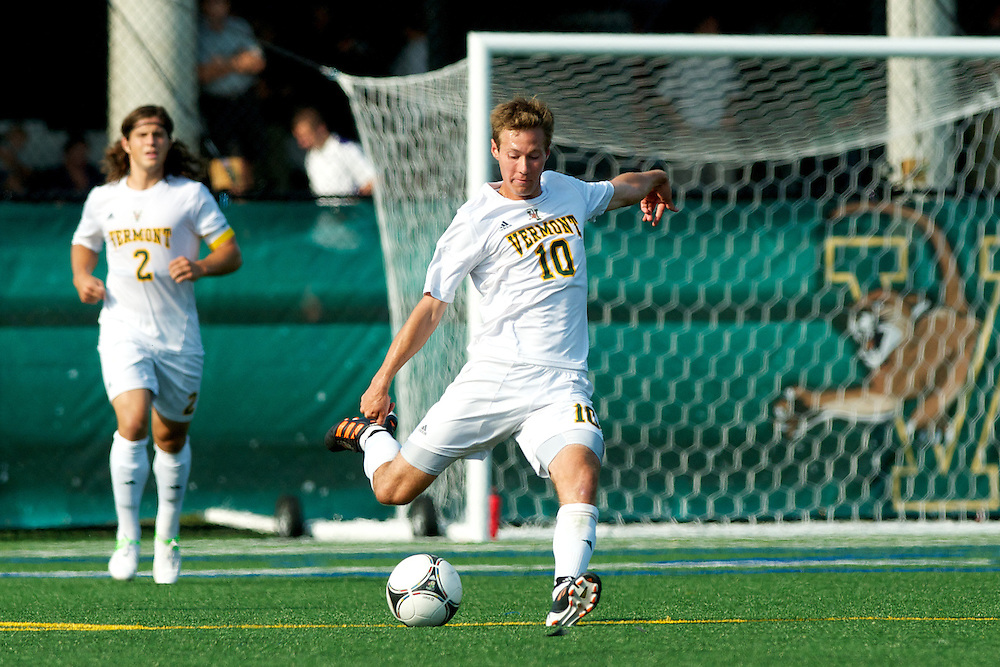 Catamounts midfielder Noah Johnson (10) kicks the ball during the men's soccer game between the Central Connecticut State University Blue Devils and the Vermont Catamounts at Virtue Field on Friday afternoon September 7, 2012 in Burlington, Vermont.