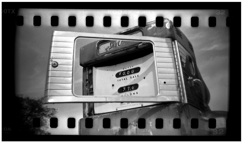 An old, broken gas pump is seen in Crawford, Texas, in this photo taken November 10, 2008. Bush moved to the small Texas town, population 705, in 1999 during his run for the presidency in 2000. The effect of the image was achieved by shooting 35mm black and white film in a medium format camera thereby exposing the entire negative including the sprocket holes of the film. REUTERS/Jim Young