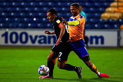Jordan Bowery of Mansfield Town puts pressure on Remy Howarth of Lincoln City - Mandatory by-line: Ryan Crockett/JMP - 06/10/2020 - FOOTBALL - One Call Stadium - Mansfield, England - Mansfield Town v Lincoln City - Leasing.com Trophy