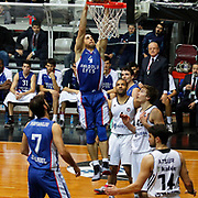 Anadolu Efes's Dogus Balbay (C) during their Turkish basketball league match Besiktas integral Forex between Anadolu Efes at BJK Akatlar Arena in Istanbul, Turkey, Monday, January 05, 2015. Photo by TURKPIX