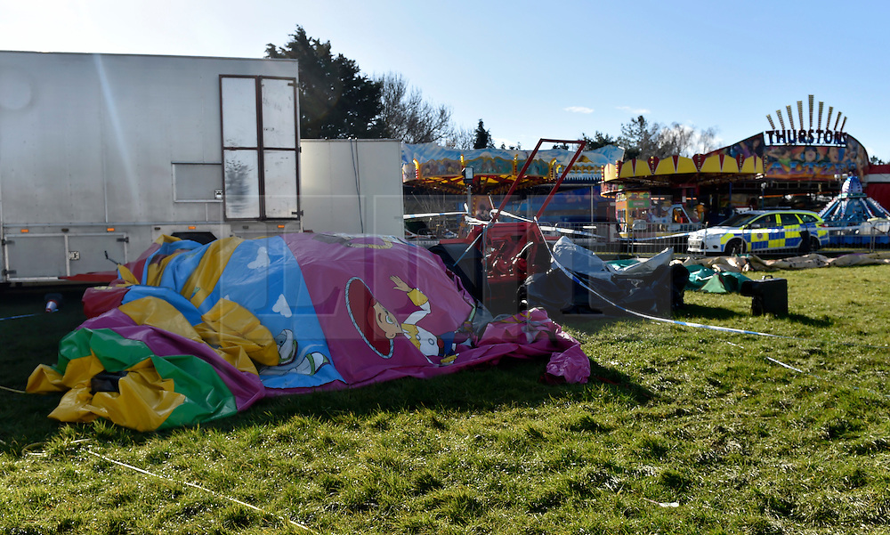 """© Licensed to London News Pictures. 27/03/2016. London, UK. A general view of a police cordon in Harlow Town park where a girl died when a bouncy castle she was playing in """"blew away by some distance"""". Two people are being held on suspicion of manslaughter by gross negligence following the incident which took place in Harlow Town Park in Essex. Photo credit : Hannah McKay/LNP"""