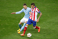 Atletico de Madrid´s Mandzukic (R) and Malmo´s Johansson during Champions League soccer match between Atletico de Madrid and Malmo at Vicente Calderon stadium in Madrid, Spain. October 22, 2014. (ALTERPHOTOS/Victor Blanco)