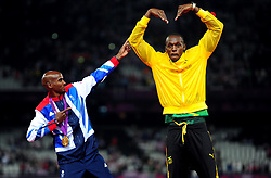 File photo dated 11-08-2012 of Great Britain Mo Farah celebrates with Usain Bolt victory in the Men's 5000m final