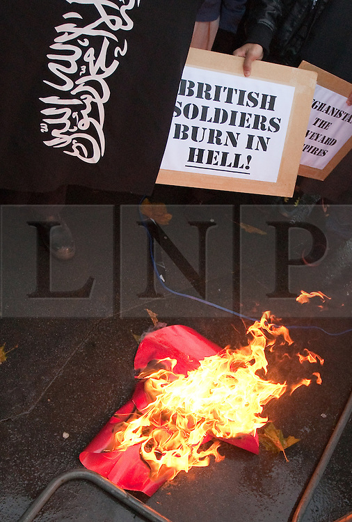 © under license to London News Pictures. Picture dated 11.11.10. Muslims burn poppies on Armistice day. Today (07/03/11) Emdadur Choudhury, 26, who burned replica poppies on the anniversary of Armistice Day, was fined £50 at Belmarsh Magistrates' Court after being convicted of a public order offence. Fellow defendant Mohammad Haque, 30, was cleared of the same charge.