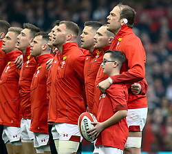 Alun Wyn Jones of Wales during the anthems<br /> <br /> Photographer Simon King/Replay Images<br /> <br /> Six Nations Round 3 - Wales v England - Saturday 23rd February 2019 - Principality Stadium - Cardiff<br /> <br /> World Copyright © Replay Images . All rights reserved. info@replayimages.co.uk - http://replayimages.co.uk