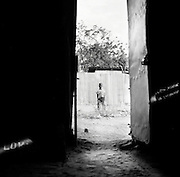 LOKICHOGGIO, KENYA - JANUARY 15, 2008: A children stands outside Grace Bible Church during a gathering.