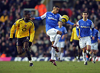 DJ Campbell  is challenged by Arsenal's Johan Djourou<br />Birmingham City 2005/06<br />Birmingham City V Arsenal 04/02/06 at St' Andrews<br />The Premier League<br />Photo Robin Parker Fotosports International