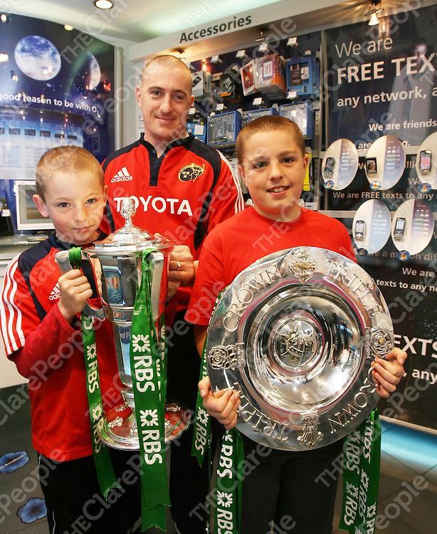 Dermott Cullinan with his sons Eric and Ian who got to hold the Six Nations and Triple Crown Silverwear at the O2 Store ,Ennis on Sunday.<br /> <br /> Photograph by Eamon Ward