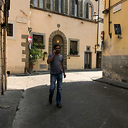 Ricing bicycles and walking are the preferred method for navigating the small, cobblestone streets of Florence, Italy.