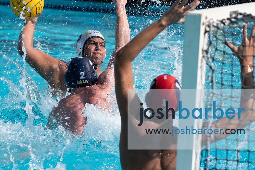 Capistrano Valley's Ethan Pranajaya scores a goal agains Santa Monica's Quinlan Plukas and goalie Aaron Akhavan during the CIF-SS Division 4 Final at William Woollett Jr. Aquatic Center on Saturday, November 10, 2018 in Irvine, Calif. (Photo by Josh Barber, Contributing Photographer)