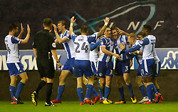Wigan Atheltic's Callum Elder (third right) celebrates scoring his side's third goal of the game during the Emirates FA Cup, Third Round Replay at the DW Stadium, Wigan.