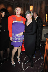 GRAYSON PERRY and his wife PHILIPPA at the Liberatum Dinner hosted by Ella Krasner and Pablo Ganguli in honour of Sir V S Naipaul at The Landau at The Langham, Portland Place, London on 23rd November 2010.