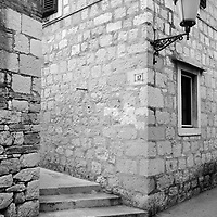 NO 17, stone wall, lamp and street steps.<br />Split, Croatia. 2018