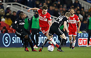 Jonathan Howson of Middlesbrough goes past Leeds United midfielder Eunan O'Kane during the EFL Sky Bet Championship match between Middlesbrough and Leeds United at the Riverside Stadium, Middlesbrough, England on 2 March 2018. Picture by Paul Thompson.
