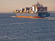 lightly laden outbound container ship  in Puget Sound.