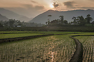 Sun sets over mountain village between Nghia Lo and Tram Tau, Yen Bai Province, Northern Vietnam, Southeast Asia