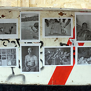 """""""Mira Mexico"""", newspaper exhibition installed on a wall in Tbilisi, Georgia  adjacent to the Museum of Modern Art. May 7, 2013.(Credit Image: © Louie Palu)<br /> <br /> Curators<br /> Jann Hoefer, Gaga Lomidze, Dina Oganova, Felix Von Der Osten.<br /> <br /> Using photographs taken by Louie Palu relating to the Mexican drug war, this project challenges the reader to take apart this newspaper to see the full photographs and view the content. The goal is to force the reader to dismantle the vehicle used to deliver news and facts and thereby empower the reader to begin to think more critically. There are 16 photos in total, eight that do not relate to violence and eight that focus on violence or the drug business. Each photograph is printed on a single sheet of newsprint, so if you take the newspaper apart each sheet of paper will have only one photograph on each side. Only eight pictures can be viewed at one time No photo can be entirely seen unless the reader opens and takes the newspaper apart. Once the newspaper comes apart it can be put back together in any order the reader wishes. The page spreads can also be hung as an exhibition. With violent images on one side and non-violent images on the other, the reader must become editor, curator or even censor, choosing how many violent photos are seen vs. how many non-violent photographs are seen. This forces the reader to face up to the fact that all delivery of news involves choices, of what to show and tell and what not to show and tell. It also forces the reader to face up to the system of institutions that serves as the gatekeepers in journalism and the visual arts. The questions are obvious. Is the editor censoring? Is the edit a true depiction of the news and the issue? Are violent images being used effectively to tell a story, or to sensationalize the story? The actual newspaper as an object forces the reader to engage in a a multidimensional exercise in journalism, art, and the politics of representation and me"""