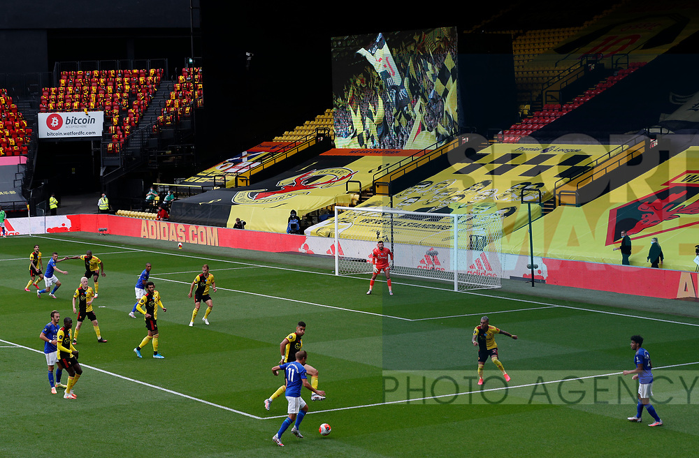A giant screen showing pictures of fans plays out in front of the teams during the Premier League match at Vicarage Road, Watford. Picture date: 20th June 2020. Picture credit should read: Darren Staples/Sportimage