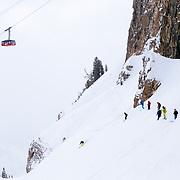 A group of female ski athletes mob skis the Expert Chutes area of Jackson Hole Mountain Resort.