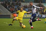 Millwall striker Aiden O'Brien (22) with a shot on goal during the EFL Sky Bet League 1 match between Millwall and Bristol Rovers at The Den, London, England on 12 November 2016. Photo by Matthew Redman.