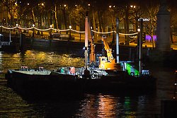 Victoria Embankment, London, January 19th 2017. Police seal off Victoria Embankment near the Houses of Parliament, following the discovery of an unexploded World War II bomb by construction workers. Two of London's busiest stations were temporarily evacuated and both Westminster and Waterloo bridges were closed for a short time. PICTURED: The construction barge from which the unexploded bomb appears to have been discovered.