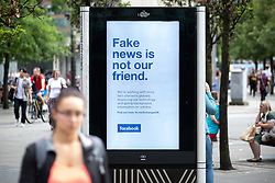 "© Licensed to London News Pictures . 26/07/2018. Manchester , UK . An advert for social media platform Facebook in Piccadilly Gardens in Manchester City Centre , which reads "" Fake news is not our friend"" . Photo credit : Joel Goodman/LNP"