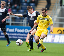 Falkirk's Conor McGrandles and Queen of the South's Michael Paton.<br /> Half time : Falkirk 0 v 0 Queen of the South, Scottish Championship game today at the Falkirk Stadium.<br /> © Michael Schofield.