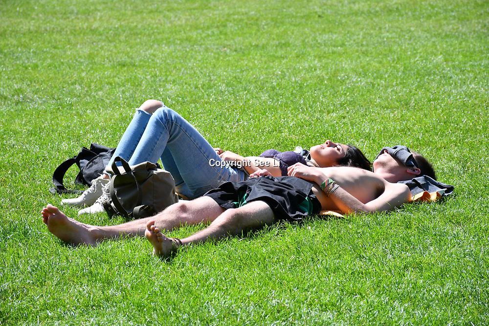 London, UK. 27 June 2019. UK Weather - People Suntan at the Hottest week in June 2019 at Green park, London, UK