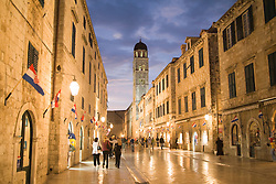 Europe, Croatia, Dalmatia, Dubrovnik.  Stradun (also known as Placa), the main street which crosses the old city, at dusk.  The historic center of Dubrovnik is a UNESCO World Heritage site.