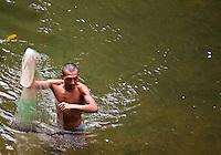 Man fishing in the river near Nanga Sumpa Longhouse in Sarawak.