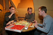 Moscow, Russia, 04/04/2004..Customers playing Monopoly at Kult Cafe, a popular restaurant and clubbing venue in the city centre.