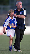 Donaghmore/Ashbourne vs Skryne u-12 football league final at Pairc Tailteann_11/06/10.Skryne mentor, Declan Smith helps Daniel Fitzpatrick with a nose bleed during the game.Photo: David Mullen /www.cyberimages.net