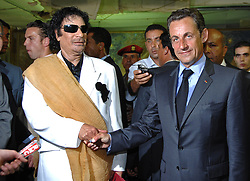 File photo - Libya's President Moammar Gadhafi (L) greets his French counterpart Nicolas Sarkozy at Bab Azizia Palace in Tripoli, Libya on July 25, 2007. Sarkozy met Gadhafi on Wednesday on a trip to deepen relations after helping to resolve a diplomatic standoff that hurt the oil exporter's ties with the West. Former French President Nicolas Sarkozy was in police custody on Tuesday morning March 20, 2018, an official in the country's judiciary said. He was to be questioned as part of an investigation into suspected irregularities over his election campaign financing, the same source added. The probe related to alleged Libyan funding for Sarkozy's 2007 campaign, Le Monde newspaper reported. Photo by Christophe Guibbaud/ABACAPRESS.COM