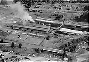 """Ackroyd 05604-2. """"Electro Metallurgical. aerials of plant. October 18, 1954"""" (near old Oregon Shipyard site in St. Johns, at the foot of Bugard)"""