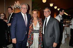 Left to right, CHRISTOPHE NAVARE CEO of Moët Hennessy, his wife and PATRICK PERRIN Director of the PAD at the PAD London 2015 VIP evening held in the PAD Pavilion, Berkeley Square, London on 12th October 2015.
