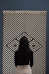 """© Licensed to London News Pictures. 09/10/2018. LONDON, UK. A visitor views """"Serape, Queretaro, Mexico"""",  1850-1950.  Preview of the UK's first exhibition of works by German artist Anni Albers at Tate Modern who used the ancient art of hand-weaving to produce works of modern art.  Over 350 of her artworks from major collections from Europe and the US are on show 11 October to 27 January 2019.  Photo credit: Stephen Chung/LNP"""