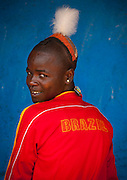 The football stars of tomorrow<br /> <br /> Thousands of Football shirts of Arsenal, Manchester, Chelsea, Milano, etc end up their carreer in... Ethiopia. Sold in the deep south, in the Omo Valley, those second hand clothes are bought by the local tribes. Most of them ignore the meaning of those shirts, and just buy them for the color, the logo, or the shape.<br /> No warrior will go out without his little pillow/seat.<br /> Some, like in Hamer tribe wear at the top of the head a clay helmet where they can put some ostrich feathers when they make a special action, like killing a wild animal, or...a man.<br /> Those tribes won't exist in few years as the ethiopian governement has launched a huge plan to develop the area.<br /> Soon, a highway coming from Mombassa - Nairobi will pass thru the villages to reach Addis Ababa.<br /> <br /> Photo shows: Hamer tribe - Brazil<br /> ©Eric Lafforgue/Exclusivepix Media