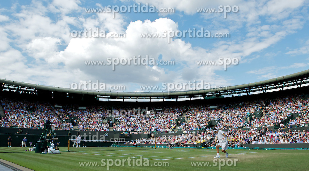 29.06.2011, Wimbledon, London, GBR, ATP World Tour, Wimbledon Tennis Championships, im Bild Bernard Tomic (AUS) in action during the Gentlemen's Singles Quarter-Final match on day nine of the Wimbledon Lawn Tennis Championships at the All England Lawn Tennis and Croquet Club. EXPA Pictures © 2011, PhotoCredit: EXPA/ Propaganda/ David Rawcliffe +++++ ATTENTION - OUT OF ENGLAND/UK +++++