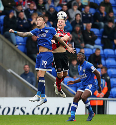 Shaun Whalley of Shrewsbury Town wins a header above Lee Erwin of Oldham Athletic  - Mandatory by-line: Matt McNulty/JMP - 03/09/2016 - FOOTBALL - Sportsdirect.com Park - Oldham, England - Oldham Athletic v Shrewsbury Town - Sky Bet League One
