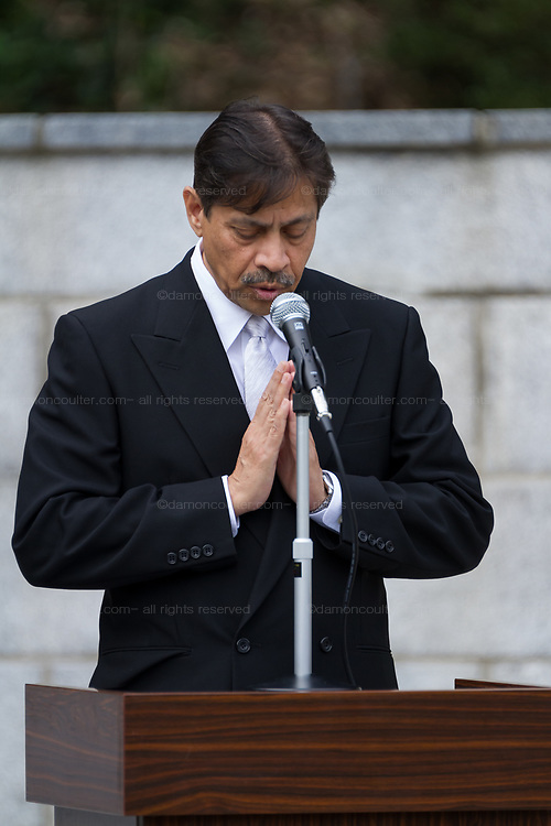 Doctor Vinit Bapat gives a Hindu prayer during the Remembrance Sunday ceremony at the Hodogaya, Commonwealth War Graves Cemetery in Hodogaya, Yokohama, Kanagawa, Japan. Sunday November 11th 2018. The Hodagaya Cemetery holds the remains of more than 1500 servicemen and women, from the Commonwealth but also from Holland and the United States, who died as prisoners of war or during the Allied occupation of Japan. Each year officials from the British and Commonwealth embassies, the British Legion and the British Chamber of Commerce honour the dead at a ceremony in this beautiful cemetery. The year 2018 marks the centenary of the end of the First World War in 1918.