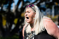 SYDNEY, NSW - SEPTEMBER 05: A woman yells out during the Freedom Day Rally on September 05, 2020 in Sydney, Australia. Protesters argue COVID-19 is a hoax and say their freedoms are being unfairly impinged. Demonstrations are also taking place in every Australian capital city and several regional areas, including Byron Bay. (Photo by Steven Markham/Speed Media)
