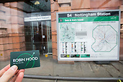 A 'Robin Hood' card outside Nottingham Station, Nottinghamshire, United Kingdom. The card offers a simple pay-as-you-go system across public transport networks in Nottingham, to make it easier for people to travel more sustainably.