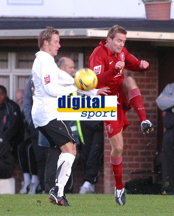 Photo: Dave Linney.<br />Hereford United v Walsall. Coca Cola League 2. 18/11/2006. Walsall's Martin Butler(R) clears the danger before   Phil Gulliver has chance to pounce.