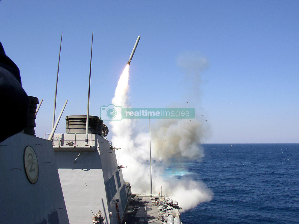 April 6, 2017 - *FILE PHOTO* - President Trump ordered a massive military strike on a Syrian air base in retaliation for a 'barbaric' chemical attack he blamed on Syria's President. Navy gun ships USS Porter and USS Ross targeted Shayrat Airfield in Syria, where planes that carried out the chemical attack where launched from. Pictured: Nov. 23, 2002 - The guided missile destroyer USS Porter (DDG 78) launches a TOMAHAWK LAND ATTACK MISSILE (TLAM) toward Iraq during the initial stages of shock and awe. Porter is deployed with coalition forces in support of Operation Iraqi Freedom, the multi-national coalition effort to liberate the Iraqi people, eliminate Iraq's weapons of mass destruction, and end the regime of Saddam Hussein. (Credit Image: © Christopher Senenko/U.S .Navy/ZUMA Wire/ZUMAPRESS.com)