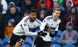 Fulham's Andre Schurrle (right) celebrates scoring his side's first goal of the game during the Premier League match at Turf Moor, Burnley.