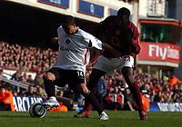 Photo: Olly Greenwood.<br />Arsenal v Charlton Athletic. The Barclays Premiership. 18/03/2006. Charlton's Jerome Thomas (L) and Arsenal's Kolo Toure battle.