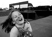 Caitlin Sholar, 9. of Junction City, KY, laughs after her brother, Trent, 11, smashed a cupcake into her face at the skateboard park at Millenium park in Danville, KY.  Caitlin, her brothers, Eli and Trent and older sister, Bethany, 13, came to the park to celebrate the birthday of friend, Emanuel, who just turned 9.  Caitlin this year joined her brothers' football team and was awarded MVP after playing well in a recent game. 10/17/07 Julia Cumes