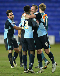 Wycombe Wanderers's Fred Onyedinma is embraced by  Paul Hayes at the end of the match Photo mandatory by-line: Richard Martin-Roberts/JMP - Mobile: 07966 386802 - 03/03/2015 - SPORT - football - Tranmere - Prenton Park - Tranmere Rovers v Wycombe Wanderers - Sky Bet League Two