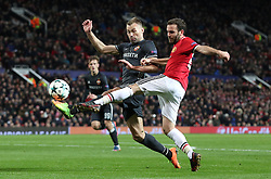 CSKA Moscow's Vasili Berezutski (left) and Manchester United's Juan Mata in action during the UEFA Champions League match at Old Trafford, Manchester.